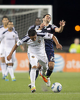 New England Revolution midfielder Benny Feilhaber (22) defends too closely as Los Angeles Galaxy forward Miguel Lopez (25) dribbles. In a Major League Soccer (MLS) match, the Los Angeles Galaxy defeated the New England Revolution, 1-0, at Gillette Stadium on May 28, 2011.