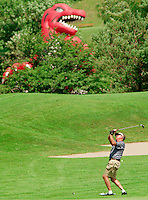 A golfer appears to make a defiant stand against the Raptors mascot during a charity golf tournament in Toronto. &amp;#xD;<br />