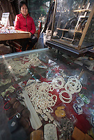 Ivory trinkets are seen for sale in an illegal shop in a jade craft market, not authorised by China's State Forestry Administration, Li Wan District, Guangzhou, Guangdong Province, China, 28 November 2013. <br /> <br /> Photo by Alex Hofford / Sinopix