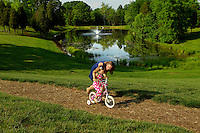 Lifestyle photography of Berewick, a 1,000-acre neighborhood development in Charlotte, NC (Steel Creek Area). Berewick was developed by Pappas Properties. Photo shows the community's iconic pond area.