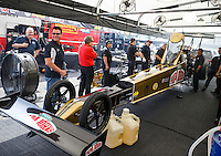 Aug 19, 2016; Brainerd, MN, USA; Papa Johns pizza founder John Schnatter (left) looks on as crew members surround NHRA top fuel driver Leah Pritchett during qualifying for the Lucas Oil Nationals at Brainerd International Raceway. Mandatory Credit: Mark J. Rebilas-USA TODAY Sports