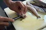 "Kenichi Yasuda, president of Harumiya Co., prepares food for an evening aboard a ""yakata-bune"" pleasure boat run by the family-run business in Tokyo, Japan on 31 August  2010. Photographer: Robert Gilhooly"