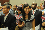 Seetala Woods holds a U.S. flag after becoming a United States citizen during a naturalization ceremony in federal court in Oxford, Miss. on Friday, June 29, 2012. Forty seven persons took the oath of citizenship.
