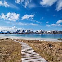 Wooden walkway leading to Ramberg Beach, Ramberg, Flakstadoy, Lofoten Islands, Norway