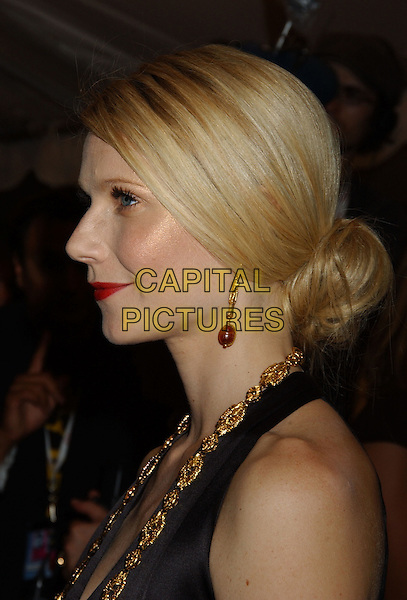 "GWYNETH PALTROW.At the ""Proof"" Premiere held at Roy Thomson Hall,.Toronto Film Festival,.Toronto, 12th September 2005.portrait headshot black satin halter neck top beads necklace gold red lips hair up bun.Ref: FARR.www.capitalpictures.com.sales@capitalpictures.com.© Capital Pictures."