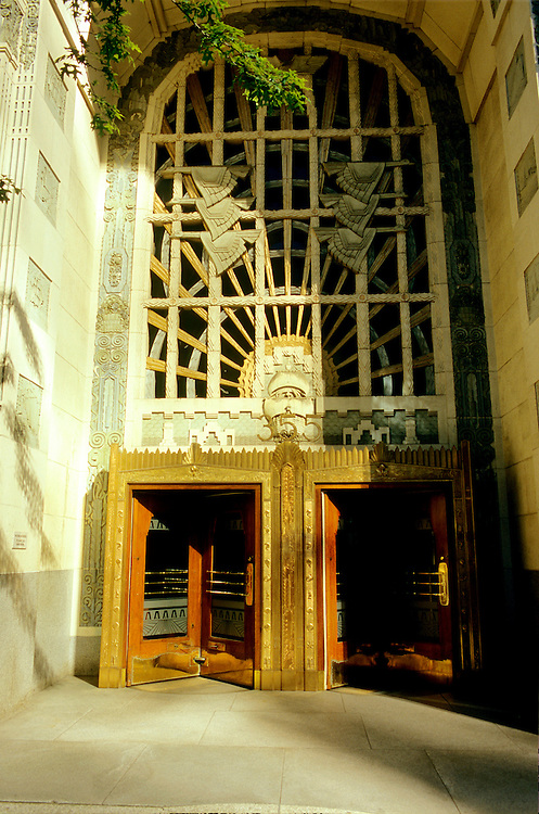 Art deco entrance with detailed ornamentation and revolving doors on the Marine Building (McCarter and Nairne, 1929-30), downtown Vancouver, BC.
