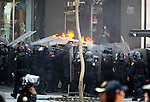 Students protest the imposition of newly President Enrique Pena Nieto, as they clash against the police in front of the Palacio de Bellas Artes building in Mexico City, December 1, 2012. More than 65 people were detained during clashes and one people is alleged to be killed early in the morning. Photo by Heriberto Rodriguez