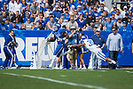 Cornerback Jerry McCray (35) narrowly misses running back Jojo Kemp (3) during the Blue/White Spring Game in Lexington, Ky., on Saturday, April 26, 2014. Blue defeated White 38-14. Photo by Adam Pennavaria | Staff