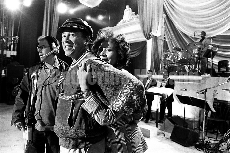 """NEW YORK - April 1993:  Aretha Franklin hugs Smokey Robinson at a rehearsal for the """"Aretha Franklin: Duets"""" concert to benefit the Gay Men's Health Crisis at the Nederlander Theater in April 1993 in New York City, New York. The concert was taped and broadcast on the Fox Network on May 9, 1993. (Photo by Catherine McGann)Copyright 2010 Catherine McGannCopyright 2010 Catherine McGann"""