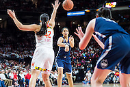 College Park, MD - DEC 29, 2016: Connecticut Huskies guard Gabby Williams (15) passes the ball around Maryland Terrapins center Brionna Jones (42) during game between No. 1 UConn and the No. 3 Terrapins at the XFINITY Center in College Park, MD. UConn defeated Maryland 87-81. (Photo by Phil Peters/Media Images International)