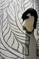 Twiggy stone mosaic in tumbled Botticino and Chinese Black.<br />