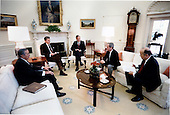 United States President Ronald Reagan listens during a National Security Briefing in the Oval Office on Thursday, June 20, 1985 on the TWA hostage crisis (from left to right) Chief of Staff Don Regan, President Reagan, U.S. Vice President George H.W. Bush, National Security Advisor Robert McFarlane, Deputy Assistant for National Security Affairs Admiral John Poindexter. .Mandatory Credit: Pete Souza - White House via CNP