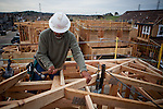 Humberto Diaz works on a new home being built in a Folsom, California development, March 15, 2013.