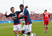 14 April 2012: Chivas USA midfielder Oswaldo Minda #8 celebrates his goal with Chivas USA midfielder Ben Zemanski #21 during the first half in a game between Chivas USA and Toronto FC at BMO Field in Toronto.