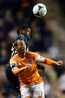 Brad Davis (11) of the Houston Dynamo goes up for a header with Sheanon Williams (25) of the Philadelphia Union. The Houston Dynamo defeated the Philadelphia Union 1-0 during a Major League Soccer (MLS) match at PPL Park in Chester, PA, on September 14, 2013.