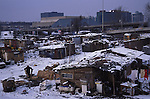 Kosovar Roma refugees, living in ramshackle squats, between the railway track and the international business centre. They make a living recycling the city's rubbish. Belgrade, Serbia Winter 2004