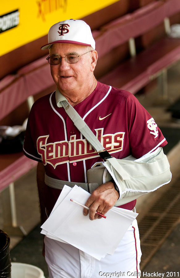 TALLAHASSEE, FL 4/12/11-FSU-UF BASE11 CH-Florida State Head Coach Mike Martin walks the dug out prior to the Florida game with his arm in a sling, Tuesday at Dick Howser Stadium in Tallahassee. Martin recently had rotator cuff surgery. The Seminoles beat the Gators 3-1. COLIN HACKLEY PHOTO