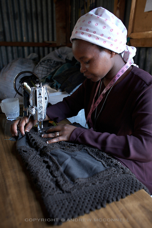 """A handmade crochet shoulder-bag produced by the Totoknits group is finished by lining the inside; pictured in the Dagoretti area of Nairobi, Kenya, in Monday, Jan. 12, 2009. The Totoknits group consists of 150 women who produce some of the crochet hand-bags, cases and scarfs for MAX&Co. The products are part of the company's """"ethical fashion"""" range in Africa which is designed to reduce extreme poverty and empower women. The limited edition collection consists of one-of-a-kind handmade accessories such as shoulder-bags, bracelets, key-rings, belts and scarfs."""