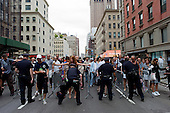 New  York, New York.September 11, 2011..Crowds gather on Church Street to get close to Ground Zero to mark the 10th anniversary of 9-11-2001 tragic attack on the US. The entire area was under extremely heave police presents during the day.