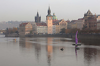 The Bedrich Smetana Museum and the 10m high purple middle finger by sculptor David Cerny, erected October 2013 in the Vltava river facing the seat of the leftist president Zeman before the parliamentary elections (far right), Prague, Czech Republic. The historic centre of Prague was declared a UNESCO World Heritage Site in 1992. Picture by Manuel Cohen