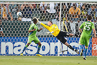 Seattle Sounders goalie Kasey Keller (18) attempts to block header by LA Galaxy forward Edson Buddle (14) during the first half of the game between LA Galaxy and the Seattle Sounders at the Home Depot Center in Carson, CA, on July 4, 2010. LA Galaxy 3, Seattle Sounders 1.