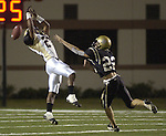 Foster's Quinn Solomon #21 misses a catch as Nederland's Joel Guidry #22 tries to tackle him during the playoff game at Galena Park Stadium, 11/23/03.  (Photo by Kim Christensen).