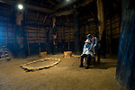 Visitors look at the interior of a reconstruction of a long house, measuring 32 meters in length at Sannai-Maruyama, a large settlement  of the early to middle Jomon era, about 5,500 to 4,000 years ago, in Aomori Prefecture, Japan on 12 July 2011..Photographer: Robert Gilhooly