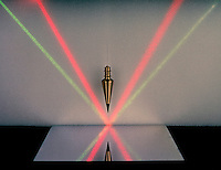 ANGLE OF INCIDENCE EQUALS ANGLE OF REFLECTION<br /> Light Beams Reflect Off Mirror<br /> A plumb bob hangs at 90 degrees, as a green light beam reflects at 50 degrees, and a red light beam reflects at 60 degrees. The light beams bounce off of the mirror and reflect at the same degree angle because the mirror surface is at zero degrees.