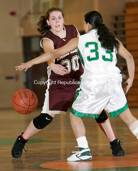 WATERBURY, CT, 12/16/08- 121608BZ07- Sacred Heart's Jennifer Massicotte (30) passes under pressure from Wilby's Adriana Mojica (33) during their game at Wilby Tuesday night. <br /> Jamison C. Bazinet Republican-American