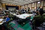 Members of Japan's Ground Self Defense Forces gather at temporary headquarters inside the Miyagi prefectural building in Sendai, Japan on 13 March, 2011. .Photographer: Robert Gilhooly