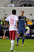 David Beckham (23) of the Los Angeles Galaxy points towards Dane Richards (19) of the New York Red Bulls prior to a free kick. The New York Red Bulls defeated the Los Angeles Galaxy 2-0 during a Major League Soccer (MLS) match at Red Bull Arena in Harrison, NJ, on October 4, 2011.