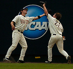 06/17/2006 Oregon State's Tyler Graham makes a catch and collides with Cole GILLESPIE in center field during game 4 of the College World Series in Omaha Nebraska Saturday evening..(photo by  Chris Machian/Prairie Pixel Group)