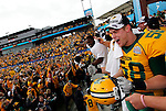 07 JAN 2012: Alex Yaggie (58) of North Dakota State University celebrates with his team and fans after beating Sam Houston State in the Division I Men's FCS Football Championship held at Pizza Hut Park in Frisco, TX. North Dakota State beat Sam Houston State 17-6. Tom Pennington/ NCAA Photos