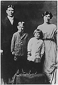"""Photograph of Ronald Reagan (with """"Dutch boy"""" haircut) Neil Reagan (brother) and Parents Jack and Nelle Reagan, circa 1914.."""