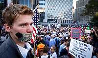 NewYork, United States, October 05, 2011..Protesters affiliated with the Occupy Wall Street movement march in Lower Manhattan's Financial District near Wall Street in New York October 5, 2011. VIEWpress / Eduardo Munoz Alvarez..Thousands of protesters including union members and college students from an organized walkout joined today's rally and march..Local media reported.