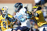 06 February 2016: North Carolina's Timmy Kelly (15) and Michigan's Parker McKee (50) and Nick DeCaprio (8). The University of North Carolina Tar Heels hosted the University of Michigan Wolverines in a 2016 NCAA Division I Men's Lacrosse match. UNC won the game 20-10.