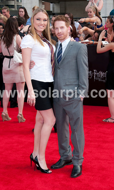 **ALL ROUND PICTURES FROM SOLARPIX.COM**                                             **UK SYNDICATION RIGHTS ONLY**    .Caption: New York premiere of Harry Potter And The Deathly Hallows: Part 2. Held at the Avery Fisher Hall, Lincoln Center, New York , USA. July 11, 2011.                                                                         This pic: Seth Green, Clare Grant                                                                            JOB REF: 13693 RHB       DATE: 11_07_2011                                                           **MUST CREDIT SOLARPIX.COM OR DOUBLE FEE WILL BE CHARGED**                                                                      **MUST AGREE FEE BEFORE ONLINE USAGE**                               **CALL US ON: +34 952 811 768 or LOW RATE FROM UK 0844 617 7637**