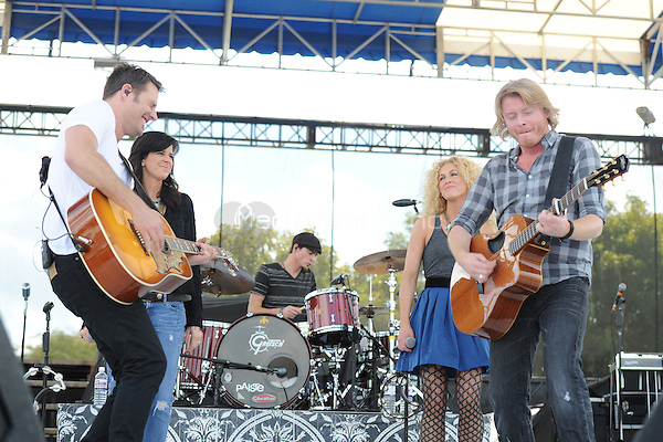 Jimi Westbrook, Karen Fairchild, Kimberly Schlapman and Phillip Sweet of Little Big Town perform at the 99.9 Kiss Country Chili Cookoff concert held at C.B. Smith park on January 30, 2011 in Pembroke Pines Florida. © MediaPunch Inc. / MPI04