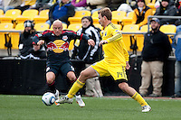 Mar 26, 2011; Columbus, OH, USA; Columbus Crew defender Chad Marshall (14) knocks the ball away from New York Red Bulls forward Luke Rodgers (9)  during their match at Columbus Crew Stadium. The game finished in a 0-0 tie.
