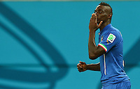 Mario Balotelli of Italy celebrates scoring his goal to make the score 2-1 by blowing a kiss to his fiance Fanny Neguesha