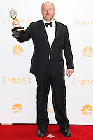 LOS ANGELES, CA, USA - AUGUST 25: Show creator, actor, Director, Executive Producer Louis C.K., winner of the Outstanding Writing for a Comedy Series Award for Louie poses in the press room at the 66th Annual Primetime Emmy Awards held at Nokia Theatre L.A. Live on August 25, 2014 in Los Angeles, California, United States. (Photo by Celebrity Monitor)