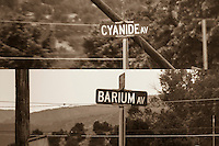 "At the corner of 9th and Elm is an entrance to a cemetery.  The two streets before Elm are Cyanide and Barium, presumably a variant of ""bury 'em"".  Canon City, Colorado."