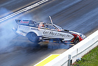 May 22, 2016; Topeka, KS, USA; NHRA funny car driver Tim Wilkerson crashes after losing an oil line during the Kansas Nationals at Heartland Park Topeka. Wilkerson was uninjured in the accident. Mandatory Credit: Mark J. Rebilas-USA TODAY Sports
