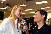 15 November 2004: Maria Sharapova (RUS) reacts after defeating Serena Williams (USA) 4-6, 6-2, 6-4 in the finals of the WTA Tour Championships on day six at the Staples Center in Los Angeles, CA.  KFWB reporter Ted Sobel interviewing Maria Sharapova in the press room.