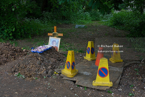 Next to a freshly-dug grave covered with traffic bollards is a recent plot for a boy n Nunhead Cemetery whose deceased occupants were important members of Victorian society from the industrial age. During this annual open day, it is an opportunity for the Friends of the cemetery to celebrate and educate Londoners, old and young - thereby helping to preserve and conserve this historic site.