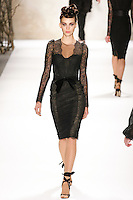 Emily walks runway in a Monique Lhuillier Fall 2011 outfit, during Mercedes-Benz Fashion Week Fall 2011.