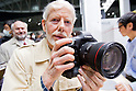 February 9, 2012, Yokohama, Japan - A professional photographer tries the new Canon EOS-1D X at the CP+ Camera and Photo Imaging Show 2012. The event is held from February 9-12. (Photo by Christopher Jue/AFLO)