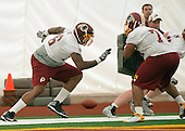 Offensive lineman Morgan Moses (76) of Virginia, who was drafted in the third round of the recent NFL draft, participates in a drill with fellow offensive lineman Clint Marsh (74) of Grambling, who is in camp as a tryout, participate in a drill during the Washington Redskins' rookie minicamp at Redskins Park in Ashburn, Virginia on Saturday, May 17, 2014.<br /> Credit: Ron Sachs / CNP