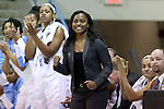 25 March 2014: UNC assistant coach Ivory Latta reacts to a basket. The University of North Carolina Tar Heels played the Michigan State University Spartans in an NCAA Division I Women's Basketball Tournament First Round game at Cameron Indoor Stadium in Durham, North Carolina. UNC won the game 62-53.