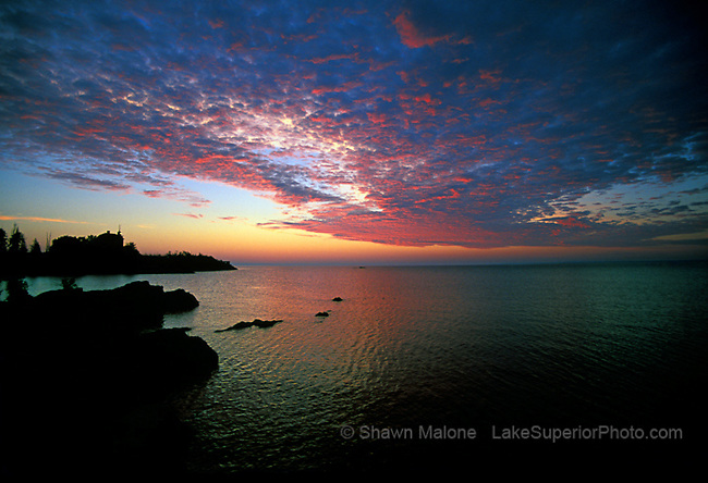 Marquette Lighthouse sunrise sillouette lighthouses in the Upper Peninsula of Michigan